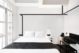 A bed or beds in a room at Hotel Mono (SG Clean, Staycation Approved)