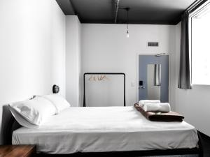 A bed or beds in a room at The Pod Sydney