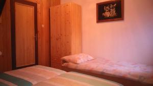 Кровать или кровати в номере Apartments T&M