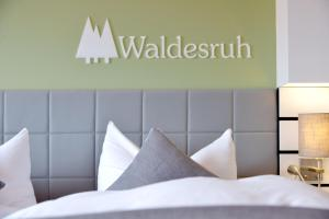 A bed or beds in a room at Hotel Restaurant Waldesruh