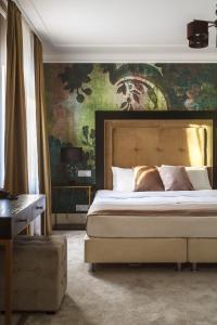 Кровать или кровати в номере Вилла Кадаши Бутик Отель