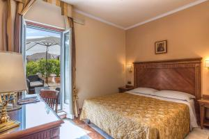 A bed or beds in a room at Tmark Hotel Vaticano