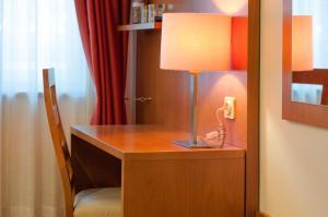 Uma televisão e/ou sistema de entretenimento em Hotel Berne