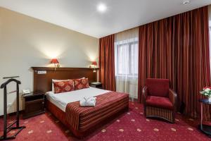 Кровать или кровати в номере Клуб Отель Корона