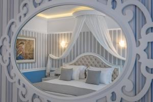 A bed or beds in a room at Rodos Palladium Leisure & Wellness