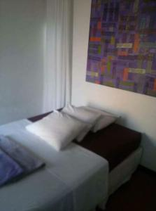 A bed or beds in a room at Mirante do Forte