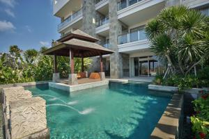 The swimming pool at or close to AYANA Residences Luxury Apartment