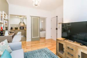 A television and/or entertainment center at LxWay Apartments Alfama - Sao Miguel