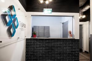 A kitchen or kitchenette at The Pod Sydney