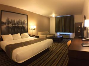 A bed or beds in a room at Super 8 by Wyndham Kenora