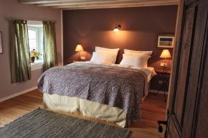 Ein Bett oder Betten in einem Zimmer der Unterkunft Die Einkehr