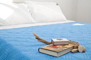 A bed or beds in a room at Residence Giuliana