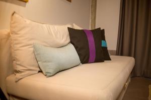 Ένα ή περισσότερα κρεβάτια σε δωμάτιο στο ThessHomeLiving