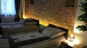 Łóżko lub łóżka w pokoju w obiekcie Apartamenty MTP