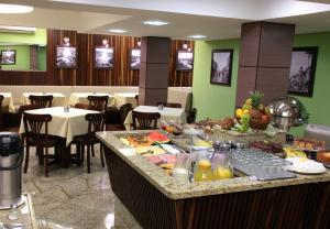 A restaurant or other place to eat at Príncipe Hotel