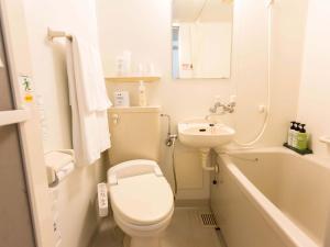 A bathroom at Hotel AreaOne Okayama