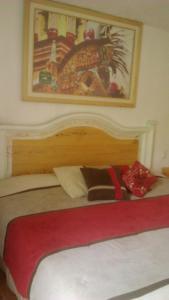 Cama o camas de una habitación en Hotel Galería Gran Puerta de la Sierra