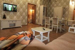 Гостиная зона в Отель Альпийская Сказка