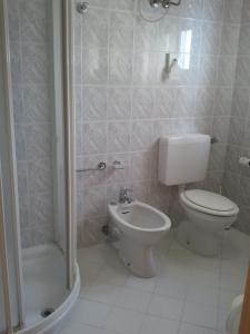 Koupelna v ubytování Hotel Berna