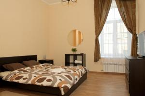 Кровать или кровати в номере Griboedova 15-1