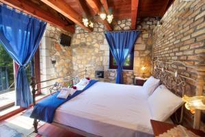 Cama o camas de una habitación en Pilikas Luxury Villas