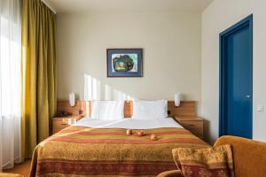 Кровать или кровати в номере BEST BALTIC Kaunas