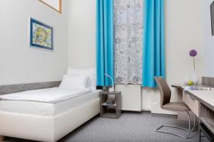 Posteľ alebo postele v izbe v ubytovaní Penzión Hradbová