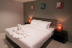 A bed or beds in a room at Nest Boutique Resort