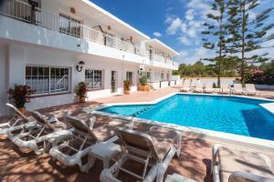 The swimming pool at or near Hostal Es Pi - Formentera Vacaciones