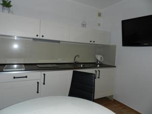 Kuchnia lub aneks kuchenny w obiekcie Gola Studio Apartment
