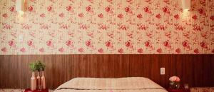 A bed or beds in a room at Pousada Macamirim