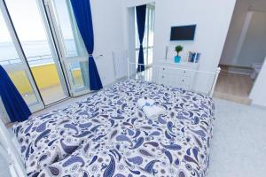 A bed or beds in a room at On the beach Sea-view&Kitchen In Room