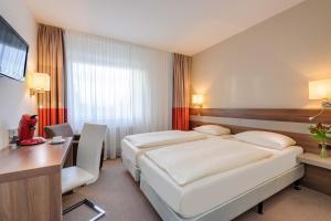 Ein Bett oder Betten in einem Zimmer der Unterkunft Mercure Hotel Greifswald Am Gorzberg