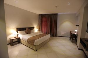 سرير أو أسرّة في غرفة في فندق جبل عمان (هيريتيج هاوس)