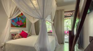 Cama ou camas em um quarto em Pousada Agua de Coco