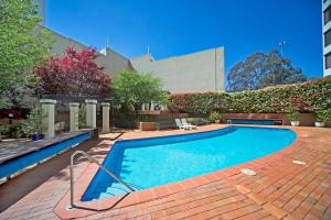 The swimming pool at or near BreakFree Capital Tower Apartments