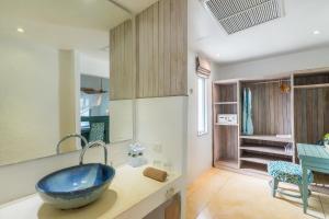 A bathroom at Paradise KohYao - SHA Plus