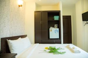 A bed or beds in a room at DDA Hotel District 1- Bùi Viện Walking Street