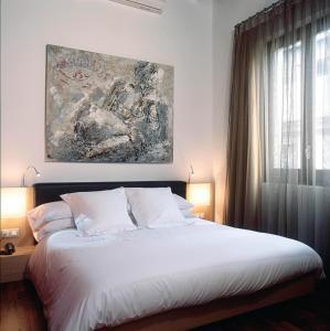 Letto o letti in una camera di Mercer House Bòria BCN