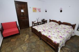 Ένα ή περισσότερα κρεβάτια σε δωμάτιο στο Ξενοδοχείο Έλλη