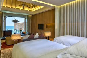 A bed or beds in a room at Hilton Ngapali Resort and Spa