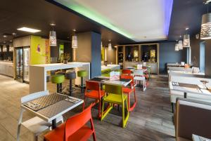 A restaurant or other place to eat at ibis budget Glasgow