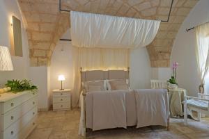 Letto o letti in una camera di Masseria Pagliamonte