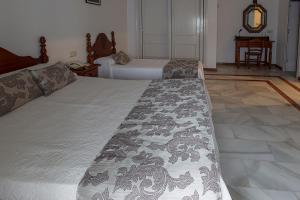Cama o camas de una habitación en Hotel La Pinta