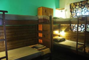 A bunk bed or bunk beds in a room at Samblumba Hostel Trindade