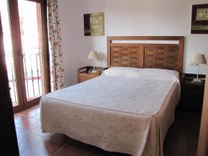Cama o camas de una habitación en Hotel-Apartamento Carolina y Vanessa