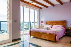 Säng eller sängar i ett rum på Villa Vista Lara