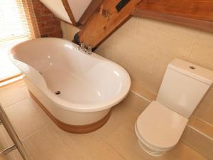 A bathroom at Courtyard Mews, 3 Rodley Hall, Leeds