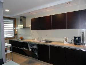 A kitchen or kitchenette at Portus Cale Apartment