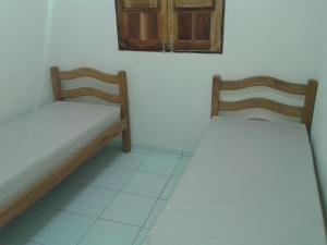 A bed or beds in a room at Casa Verde Maragogi